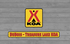 Decorative Photo Showing DuBois Treasure Lake KOA Logo
