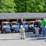 Decorative Photo Showing the start of a company Golf Outing at Treasure Lake.